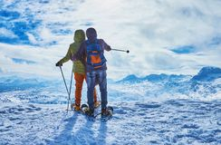 Snowshoe hike for the couple, Dachstein-Krippenstein, Salzkammergut, Austria stock images