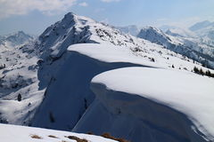Snowshoe hike to Rippetegg peak. Austria Royalty Free Stock Images