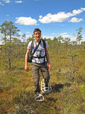 Snowshoe hiking man. Young man enjoying a snowshoe hike in Store Mosse Nationalpark, Sweden Stock Photo