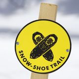 Snowshoe trail sign. A yellow snowshoe trail sign Stock Images