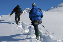 Snowshoe trip. Two men on winter snowshoe trip Stock Image