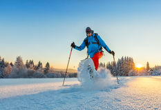 Snowshoe walker running in powder snow Royalty Free Stock Photography