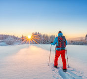 Snowshoe walker running in powder snow. With beautiful sunrise light. Outdoor winter activity and healthy lifestyle Royalty Free Stock Images