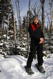 Snowshoeing. A young woman snowshoeing in Quebec Stock Photo