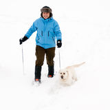Snowshoeing con el perro Imágenes de archivo libres de regalías