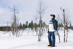 Snowshoeing Frau Stockfotografie