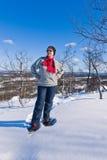 Snowshoeing Frau Stockbild
