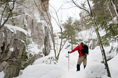 Snowshoeing on Silhouette Trail, Killarney Provincial Park. An active male explores the granite ridges and rock falls of the Silhouette Trail on snowshoes in Stock Image