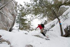 Snowshoeing on Silhouette Trail, Killarney Provincial Park. An active male explores the granite ridges and rock falls of the Silhouette Trail on snowshoes in royalty free stock image
