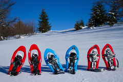 Snowshoeing. Snowshoes in the snow. Royalty Free Stock Image