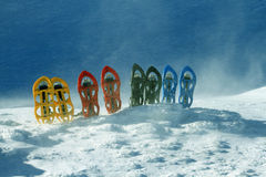 Snowshoeing. Snowshoes in the snow. Stock Photo