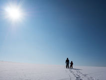 Snowshoeing in the sunlight Royalty Free Stock Photography