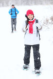 Snowshoeing winter hiking. Active couple on snowshoes outdoors in snow walking in natural park in Canada, Quebec Stock Image