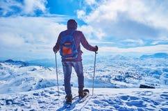 Snowshoer on the mountain peak, Dachstein-Krippenstein, Salzkammergut, Austria stock image