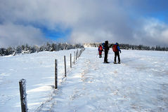 Snowshoers in winter Fischbacher Alpen mountains near Stuhleck resort in Styria Royalty Free Stock Image
