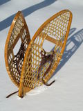 Snowshoes. Vintage snowshoes planted in fresh snow fall stock image