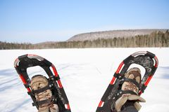 Snowshoes. From a winter hike by a frozen lake in Quebec, Canada royalty free stock images