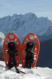 Snowshoes. A pair of snowshoes against a distant mountain royalty free stock photography