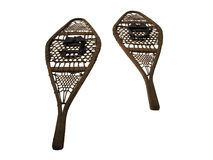 Snowshoes. Two antique snowshoes over a white background royalty free stock photos