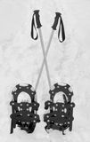 Snowshoes And Crossed Hiking Poles Stock Photo