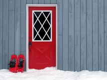 Snowshoes at the door Royalty Free Stock Image