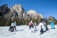 Snowshoes, group of hikers in the mountains in the snow Stock Photo