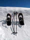 Snowshoes and Poles. Against a towering snow drift Royalty Free Stock Photo