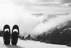 Snowshoes in snow at mountain peak, nice sunny winter day Royalty Free Stock Photo