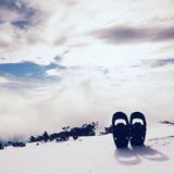 Snowshoes in snow at mountain peak, nice sunny winter day Stock Photography