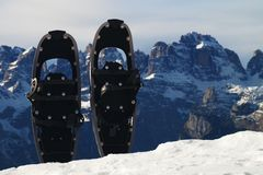 Snowshoes in snow at mountain peak, nice sunny winter day Royalty Free Stock Photos
