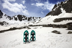 Snowshoes in snow mountain Royalty Free Stock Photos