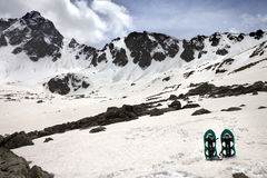 Snowshoes in snow mountains in sun spring day Royalty Free Stock Images
