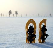 Snowshoes in a snowy landscape. (color toned image royalty free stock photos