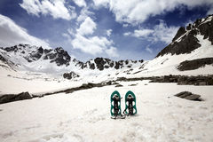 Snowshoes in snowy mountains Royalty Free Stock Photo