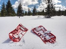 Snowshoes standing in snow against of snowy hills and mountains. Stock Photo