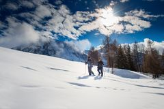 Snowshoes walk in the mountains of a couple.  stock images