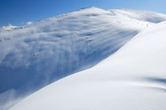The snowslope in mountains Royalty Free Stock Photos