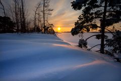 snowsolnedgång arkivfoto