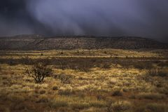 Snowstorm Approaching Verde Valley. Dramatic sky over Verde Valley as a snowstorm rolls in, with mountains in the background, near Clarkdale, Arizona royalty free stock image