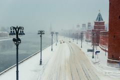 Snowstorm in the city of Moscow, the road near the walls of the Kremlin, view of the winter city. Russia stock images