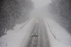 Snowstorm on freeway Stock Photography