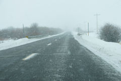 Snowstorm on highway Stock Photos