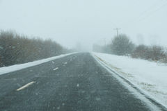 Snowstorm on highway Royalty Free Stock Images