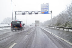 Snowstorm on the highway in Netherlands Royalty Free Stock Photography