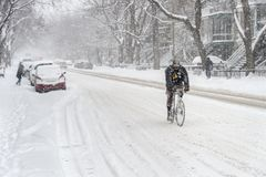 Snowstorm In Montreal. Snow Biking. Royalty Free Stock Image