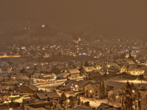 Snowstorm in a Little Village in Switzerland. Village in Switzerland by night and snowstorm Royalty Free Stock Images