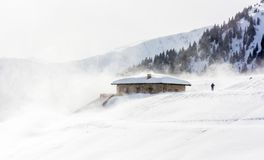 Snowstorm in the mountains at winter time. Mountains of Trentino Alto Adige, South Tyrol. Hiker ski in poor visibility due to a snowstorm in the South Tyrolean stock photo