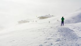 Snowstorm in the mountains at winter time. Mountains of Trentino Alto Adige, South Tyrol. Hiker ski in poor visibility due to a snowstorm in the South Tyrolean stock photography