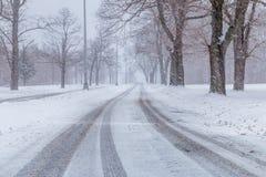 Snowstorm at non urban area. Snowing car path Stock Photos