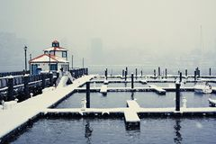 Snowstorm in NYC. A view on Manhattan from NJ side. Snowstorm in NYC. A view on Hudson river from empty boat docks. Low visibility Stock Photo